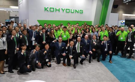 The Koh Young team celebrating teamwork and success at the 2019 IPC APEX Expo