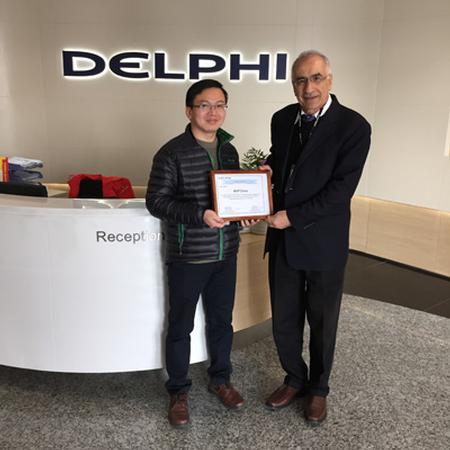Dr. George Ayoub accepts the Delphi China Appreciation Award