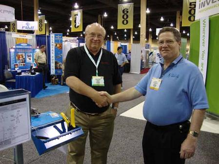 Roger Thomson, President of Conelec of Florida Inc. (left) purchasing the SMT Splicing Cart from Ken Bliss, President and Owner of Bliss Industries.