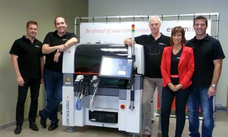 Essemtec Benelux building from inside, team in front of Paraquda pick-and-place machine