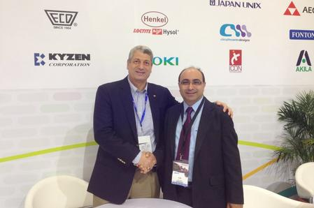 Frank Bose, (on the right) Managing Director of Essemtec, shakes hands with Hamed El Abd, (on the left) Executive Director of WKK.