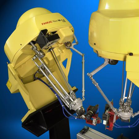 Advanced FANUC-made robotic systems inspecting and assembling a printed circuit board.