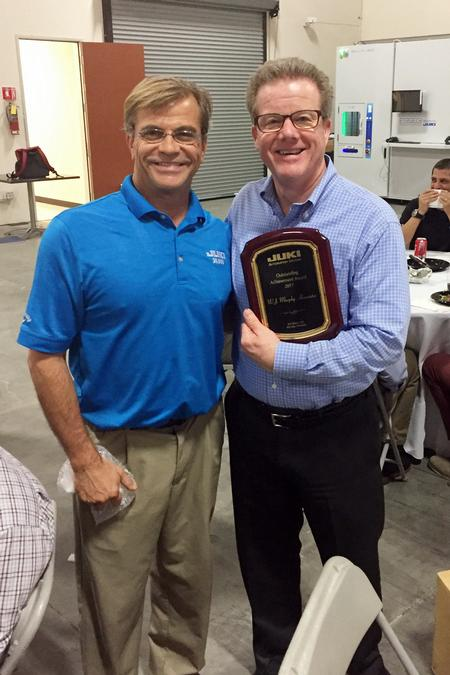 Bill Astle, President of JAS, Inc., presented the award to David Murphy at the Juki awards banquet.