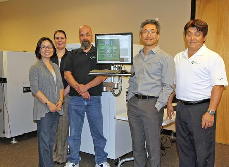 Koh Young America staff members gather in the new Training and Process laboratory at KYA's new facility in Chandler, AZ, with General Manager Harry Yun (Second from right).
