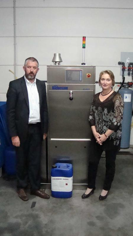 "Serge Tuerlings, Technical Manager for Kyzen in Europe, and Riebesam's European Sales Manager Mrs. Julia Vielhaber press the ""start"" button on the Riebesam 23-03T"