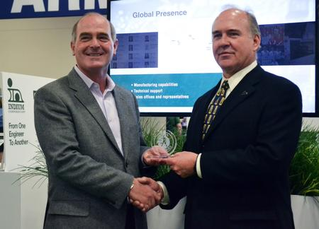 Rod Howell, Libra Industries' CEO, presented the award to Patrick Ryan, Americas Sales Manager at Indium Corporation, during the recent IPC APEX EXPO.