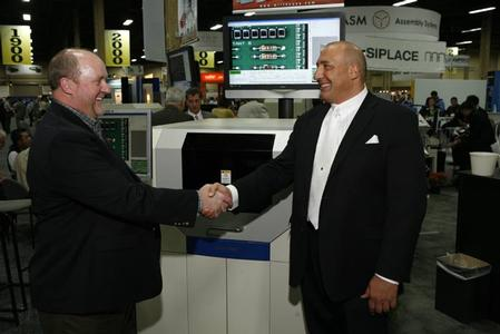 Marty Crow of Victron (left) and Brian D'Amico of MIRTEC (right) celebrating the sale of the first of multiple MIRTEC MV-7U In-Line Automated Optical Inspection (AOI) Systems to be purchased by Victron, Inc.