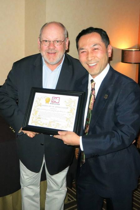 Tetsuro Nishimura, President of Nihon Superior, presents recognition awards to Josef Jost, President of Balver Zinn.