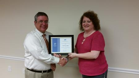 Christy Hill recently celebrated her 10-year anniversary with the company.