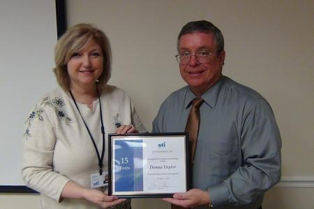 David Raby recognizes Donna Taylor's 15-year milestone