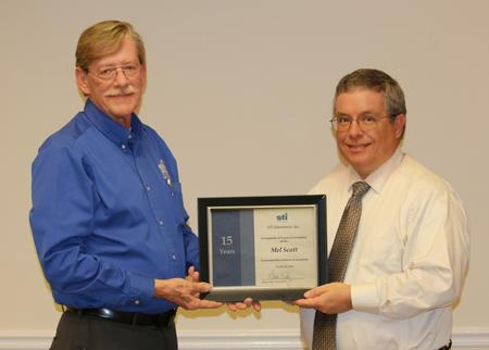 David Raby, President/CEO, presented Scott with a certificate in appreciation of his15 years of dedicated service.