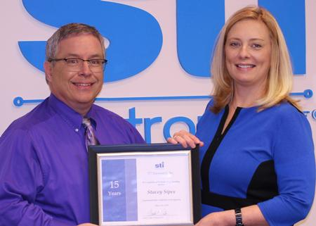 Stacey Sipes' 15-year anniversary.David Raby, President/CEO, presented her with a certificate in appreciation.