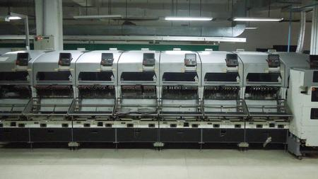 Mobile phone circuit board assembly equipment.