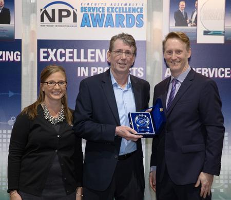 L to R: Kester's Marketing & Communications Specialist, Michelle O'Brien, and Technical Manager, Denis Jean, accept their NPI award from Circuit Assembly's Mike Buetow.