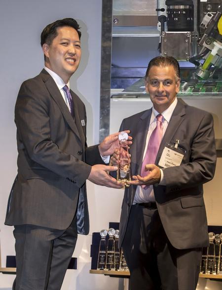 Garrett Wong accepts award from Trevor Galbraith.