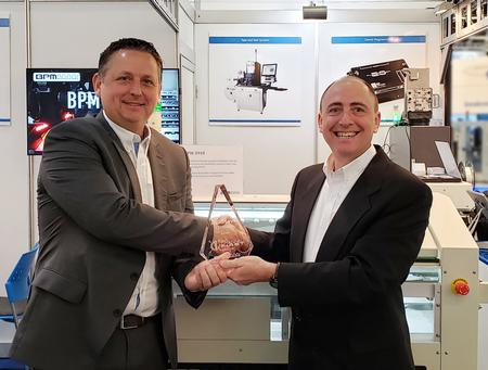 James Cawkell, Global Sales Director for the Adaptsys Group receives the Global Sales Award from James Holava, Global Account Director for BPM Microsystems at the recent SMT Connect Trade Show in Nuremberg, Germany