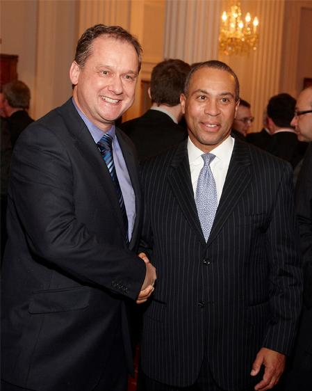 XJTAG CEO Simon Payne (left) with Deval Patrick, Governor of Massachusetts (right). Photograph by Clive Totman.