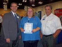 From left to right: IPC President & CEO John W. Mitchell, Sue Fischer of Plexus, third-place winner, and Lance Larrabee, General Manager of Cobar Solder Products Inc.