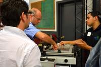 Hands-on instruction during a recent paste-place-reflow workshop at DDM Novastar.