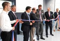 Phillippe Latombe, Député de Vendée (third from right), aided by Parable Trust's Robert Conway (centre) and other local dignitaries, cuts the official opening ribbon held by Gaby Chataigner (far right) and Corentin Rabaud (left): the longest serving and newest Europlacer employees respectively.