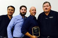 From left to right: Carlos Eijansantos – Juki's Western Regional Sales Manager, Roberto Ferraretto – Senior Service Engineer, Essegi, Bill Butt – Principal, Quantum Systems, and Bob Black – President & CEO, JAS, Inc.