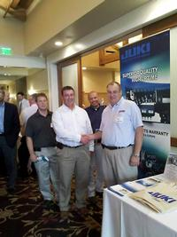 At the Michigan SMTA Seminar and Vendor Show held at Oak Pointe Country Club in Brighton, MI on May 19, 2011. From Right: Bob Watters, Juki Regional Manager; Frank Garcia, SMT Engineer; Mike Glass, Vice President of Operations; and Travis Wilson, Process Engineer.