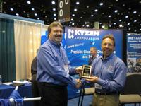 Eric Bromley (left), Kyzen Regional Manager, congratulates Terry O'Neal (right) on winning the award.