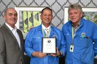 Libra Industries CEO Rod Howell presenting the service award to Bob Thibodeau.