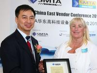 The award was presented to Megan by SMTA China's Abby Tsoi during a ceremony on April 22, 2015.