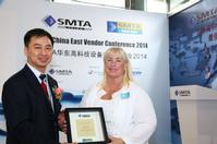 Megan Wendling receives her sixth SMTA China Councilor of the Year award from SMTA China's Abby Tsoi at a ceremony held at the recent NEPCON China