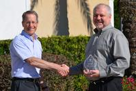 David Wolff, President of P. D. Circuits, awards EMC3 Group's Mike Guild as Sales Person of the Year