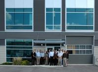 Tim Smith, PTNA Vice President Operations (far left) welcomes his colleagues for the 2012 PTNA Sales Meeting at the new Sales and Technical Center in Ancaster (Canada).