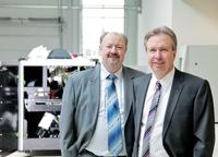 From left to right:  Volker Pape, Dr. Martin Heuser, founder and member of the Executive Board, Viscom AG.