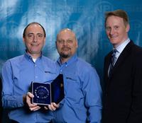James Holava, BPM's Global Sales Director and Scott Bronstad, Marketing, accept the 2019 NPI Production Software Award on behalf of BPM Microsystems. Presenting is Circuit Assembly Magazine's Editor-in-Chief Mike Buetow
